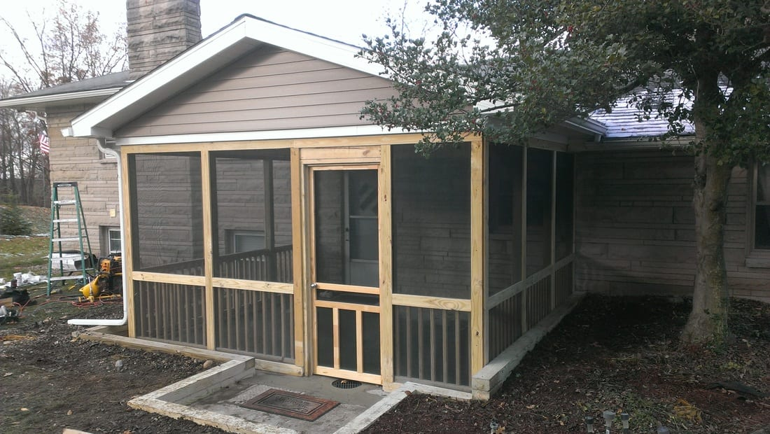 Screened in deck construction project